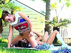 Cheerleader sitting on lesbian lover's face