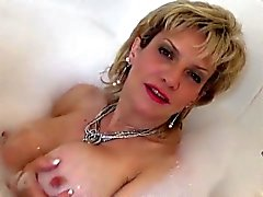Unfaithful british milf gill ellis exposes her large boobies