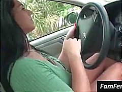 Busty brunette Bella Reese flashes her big tits in the car