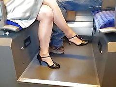 crossed legs with sheer pantyhose on train