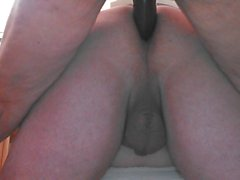Lady J likes to fuck with the big brown strap-on