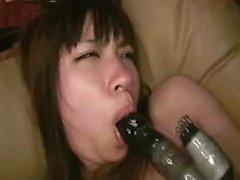 Cute Asian girl has a lustful lesbian drilling her peach wi