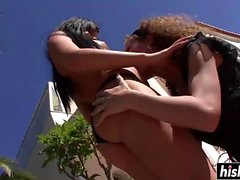 Stunning lesbians finger each other outdoors