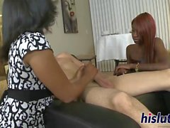 Two ebony vixens suck a white rod