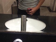 Jerk-off before the bathroom mirror that is public
