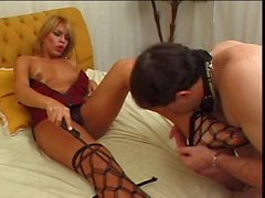Blonde tranny having fun with her bound & gagged slave
