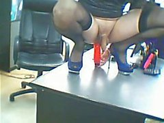 CD play with dildo in office