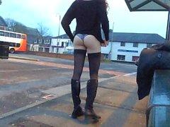 Tranny daring public bus station