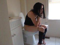 Skinny MILF on toilet 1