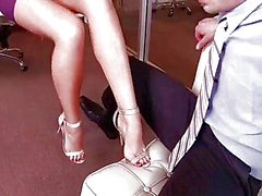 classy blonde enjoys hot footsex in the office