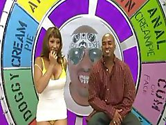 Busty ebony on a sex game show measures, blows, and fucks big black cock