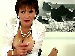 Lady Sonia rubs cock with tits