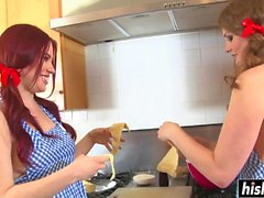 Two girls masturbate in the kitchen