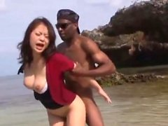 Japanese girl fucked by two blacks on the sea shore