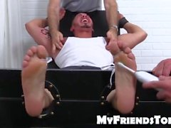 Young and cute Javy gets tandem tickled on strap chair
