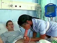Black nurse sucks and fucks big white cock