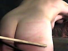 Tattooed sub caned and toyed
