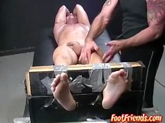Restrained hot guy wanks while being intensely tickled