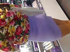 Sexy Asian in purple dress showing thong