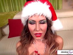 Naughty elf Jessica Jaymes sucking santas monster cock