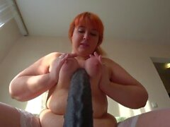 'BBW sucks and jumps on the big and black rubber penis'